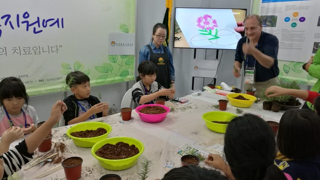 Matthew J Wichrowski MSW HTR, Senior Horticultural Therapist, Clinical Assistant Professor, Rusk Rehabilitation NYU Langone Medical Center, engaged in horticultural therapy demonstration with school group at Jangheung International Integrative Medicine expo October, 2016