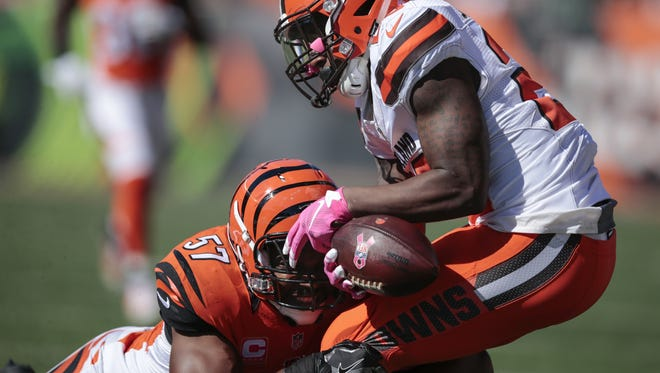 Cincinnati Bengals outside linebacker Vincent Rey (57) breaks up a pass intended for Cleveland Browns running back Duke Johnson (29) in the first quarter during the NFL Week 7 football game between the Cleveland Browns and the Cincinnati Bengals, Sunday, Oct. 23, 2016, at Paul Brown Stadium in Cincinnati. Cincinnati leads 21-10 at halftime.
