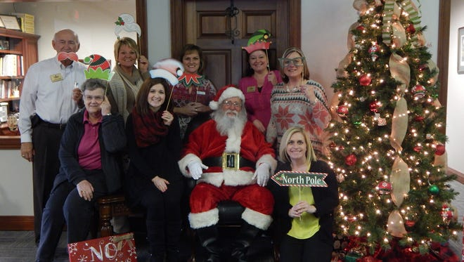 On Tuesday, December 13th, Santa paid a visit to United Community Bank. Pictured (front row, left to right) are Linda Wedding, Kristy Hancock, Laura Elder; (back row, left to right) Garland Certain, Gail Sheffer, Lisa Manis, Betty McGehee, and Ruth Montgomery.
