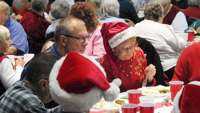Mike and Cinda Wilson enjoyed a free Christmas meal at North Terrace Church of Christ Thursday.