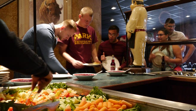 Military men and women enjoy Christmas dinner at Cattleman's Cut Supper Club.