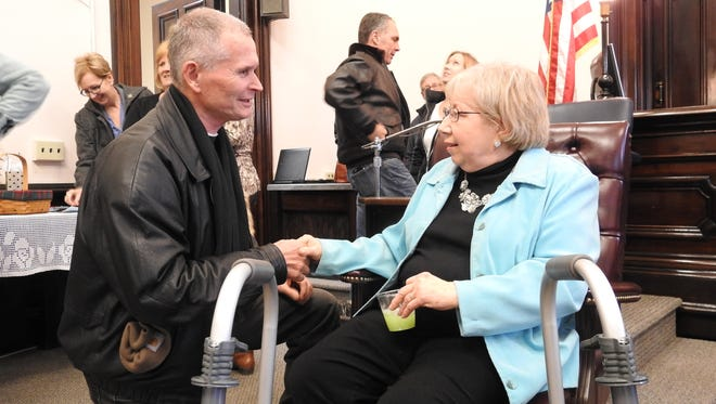 County Engineer Fred Wachtel thanks Janet Mosier for her years of public service during a reception in her honor. Mosier retired from her post as Coshocton County Clerk of Courts at year's end.