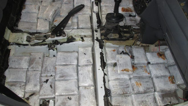 U.S. Customs and Border Protection officers seized more than 100 pounds of marijuana hidden in the floor of a car Friday at the Santa Teresa Port of Entry.