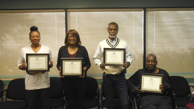 Winners of the second round of the Good Neighbor award are Claudia Larkin, Julia Howard, Willie Crowder and Myron Wilson. (Not pictured: Charlie Brown Jr.)
