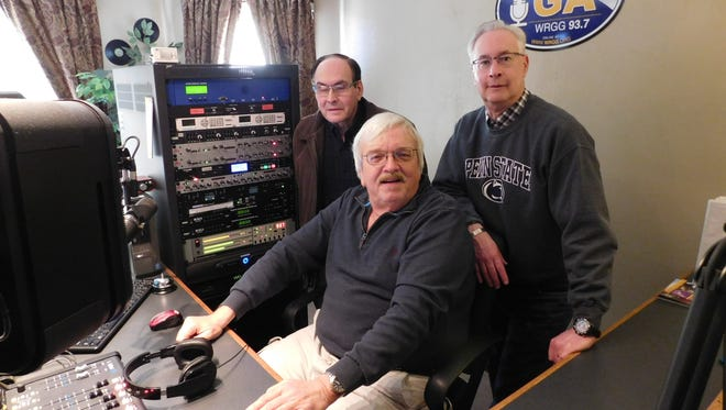 Standing, from the left, Wade Burkholder and Ben Thomas are two of the founders of WRGG-93.7 FM radio station in Greencastle. Seated is Gary Kline, a DJ for the station. Greg Hoover, not pictured, founded the station with Burkholder and Thomas.