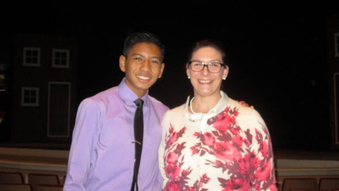 Francis Virtucio (left), sophomore, Vineland High School, and Vanessa Rasmussen, English Department Chairperson, Vineland High School, celebrate Virtucio's win at the Poetry Out Loud Regional Competition held on Feb. 15 at the Levoy Theatre in Millville.