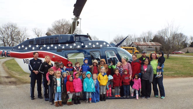 Highland Rime Headstart students with Air Evac 37 helicopter and Pilot Matthew Blackwell, Rich Hunter and Ashley Turner.