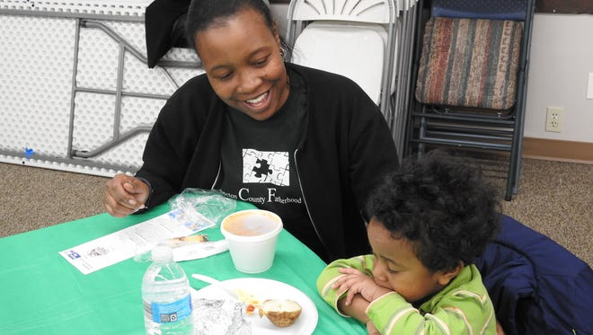 Leondra Davis and her son WIlliam, 3, of Coshocton, stopped by the County Services Building Thursday for a chili lunch benefiting the Coshocton County Fatherhood Initiative, which Davis volunteers for.