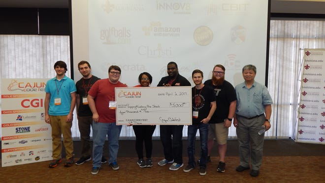 "First place: Hayes Guidry, Joseph ""Alex"" Fontenot, Blake Glaub, Joy Norwood, Ben Norwood, Connor Stanford, Dillon Boudreaux, and presenter Henry Chu, Ph.D., Informatics Research Institute"