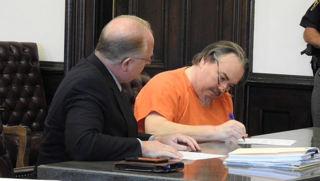 Daniel J. Reeves, right, of Warsaw, waived his rights to indictment and a jury trial and pleaded guilty to felony charges in connection with burying his grandmother in his yard to collect her Social Security benefits. He remains in custody in the County Jail while awaiting sentencing.