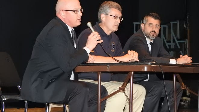 Common Pleas Judge Robert Batchelor, Emergency Medical Services Director Todd Shroyer and County Prosecutor Jason Given, from left, visited Coshocton High School Monday to tell students about the consequences of driving drunk. Their educational presentation is one of several events planned  for this week leading up to Saturday's prom.
