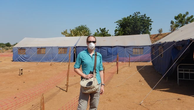 Dr. Aimee Summers at the Senegal-Mali border visiting a newly constructed waiting structure for suspect Ebola cases during the 2014-2015 Ebola epidemic in West Africa.