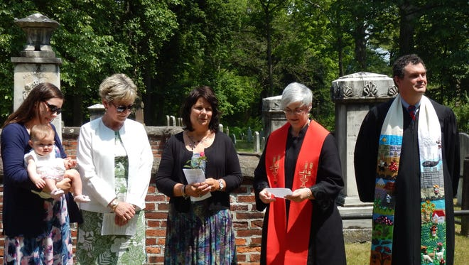 Three generations of the family of Benjamin Chambers participated in the 249th annual Rose Rose ceremony at Presbyterian Church of the Falling Spring on June 4. Pictured from left to right: Sarah Lenard (8th generation) with Margaret Lenard (9th generation), Catherine Gartenberg (7th generation, Board of Trustees), Deb Petrilla (Memorial Rose Committee), Reverend Laura Hart, Reverend Dr. Andrew Hart.