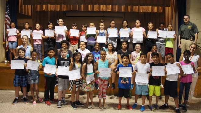 The Linden Police Department and Linden Detective Afstratio Zevlikaris congratulated the Safety Patrol of School No 6 on June 20. The students were awarded certificates for their service as Safety Patrols during an assembly. The Safety Patrol of Linden School No. 6 is a select group of about 40 fifth- and fourth-graders that are committed to assisting in providing a safe school environment for all students.