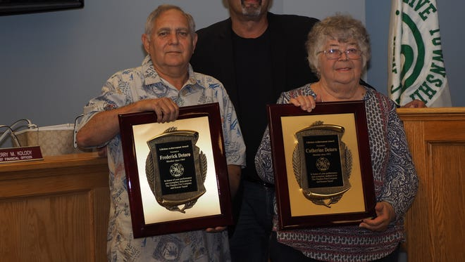 Mount Olive Mayor Rob Greenbaum honors husband and wife firefighters Fred and Catherine Detoro for nearly 100 years of service to the township.