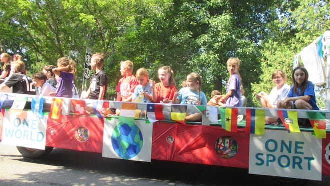 Spencer Picnic begins in just two weeks, so it's time to think about building a float, which booth to help in, and what night to enjoy the rides. This SVE Soccer Club float was in last year's parade.