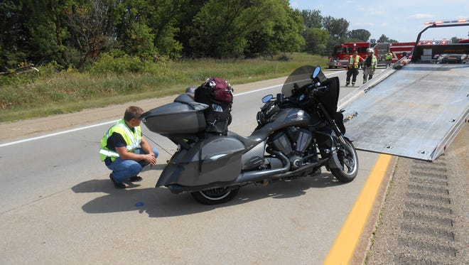 Deputies inspect the motorcycle after the Thursday crash.