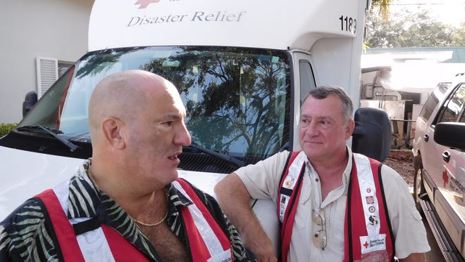 Red Cross volunteers Art Cimini left,  and  Mark Milia talk about their trip to aid people displaced by Hurricane Harvey