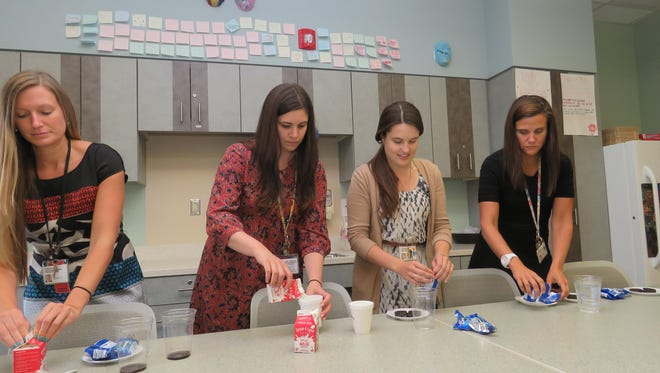 Patricia Gazzola (second from left) and other members of the eating disorders team prepare snacks for patients at the Eating Disorders Program based in the Goryeb Children's Center at Overlook Medical Center in Summit.
