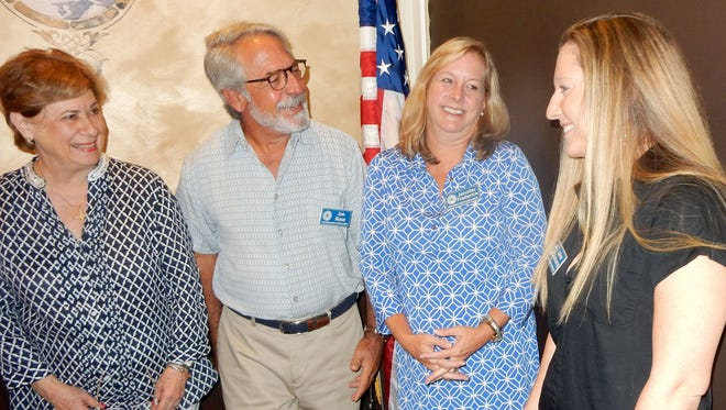 Committee members Barbara Parent, Jonathan Rose, Jenny Frederick and Jaime Klekamp discuss plans for Exchange Club of Indian River Foundation's 2016 Black & White Masquerade Ball.