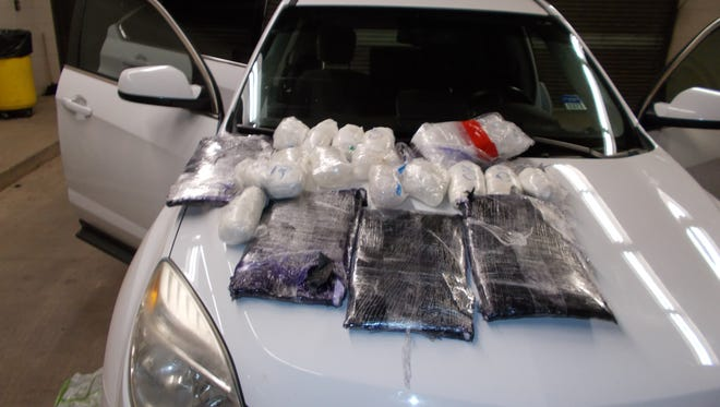 Approximately 26pounds of methamphetamine and nine pounds of cocaine were found during a search of the vehicle Roberto Lorenzo-Ruiz and Manuel Gallardo were allegedly driving.