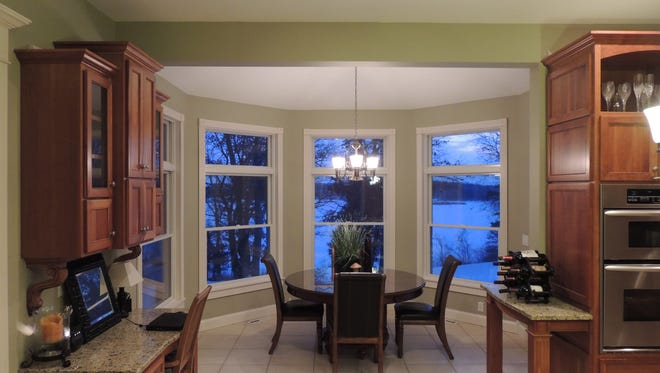 Windows wrap around a dining cove at 21643 Stearns County Road 44, Clearwater.