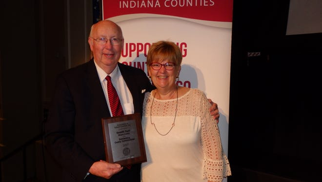 AIC President Terri Rethlake, St. Joseph County clerk, presents the 2017 Outstanding County Commissioner Award to Wayne County Commissioner Kenneth Paust.
