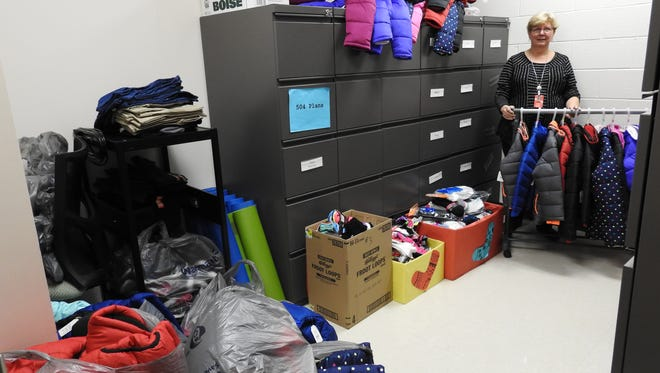 Laura Grogro, counselor at Coshocton Elementary School, in a room full of clothes that were donated or purchased with donated funds for students at the school.