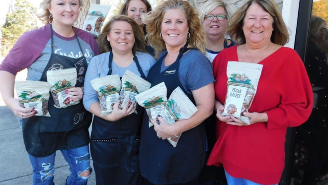 The ladies at Shear Attraction are supporting the annual pecan fundraiser for the Ashland City Civitan Club.