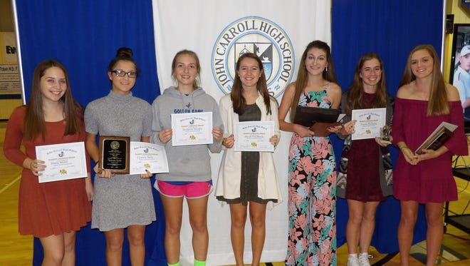 With their awards are, from left, Maria Miller, senior; Victoria Sarlo, senior, team co-captain and winner of Coaches' Spirit Award; Bridgette Murphy, senior; Devan Fischbeck, senior; Gina Carvelli, senior, team co-captain, Team MVP and Four Year Letterman awards; Tatiana Boehning, senior, Four Year Letterman Award; Cami Bates, sophomore, Most Improved Golfer Award.