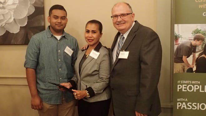 Howard and Eva Kimlin present the Lorien Niniel Kimlin scholarship to Ryan Mongroo during an event last year.
