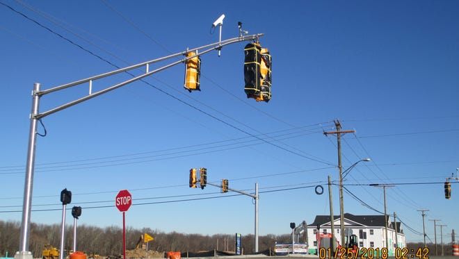 The traffic signal at Mount Mills Road and Spotswood Englishtown Road in Monroe remains covered and inoperable four months after it was installed.