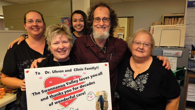 Saying goodbye to patients who loved them for years is the staff of Dr. Robert Uhren's family practice. From left, they are Nikki Slaughter, Cathy Hart, Addy Eddings, Dr. Uhren and Trish Morris (not pictured is Donnika Hart).