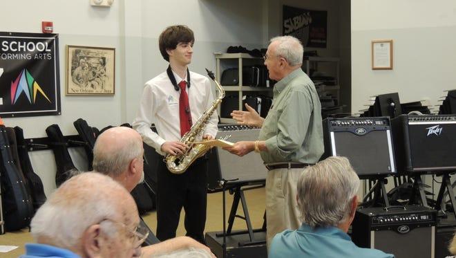 Indian River Charter School alto sax player Zane Chapman with Burr Wishart Scholarship committee chair.