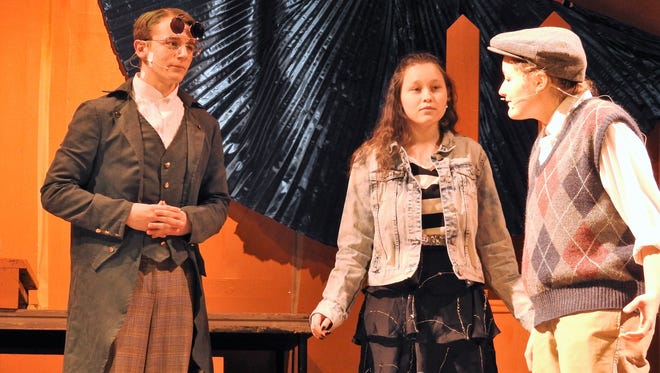 """Cole Fisher as Green Grasshopper, Halley Jones as Spider and Kenzie Potter as James in a scene from """"James and the Giant Peach"""" playing at Coshocton High School."""