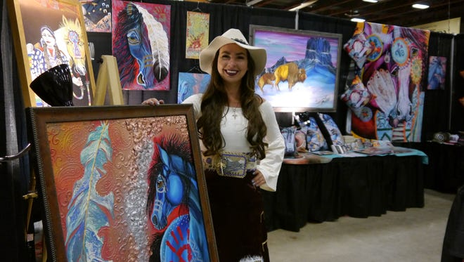 Sammy Jo Bird shows her work at the Western Living and Design Show Thursday at the Four Seasons Arena.