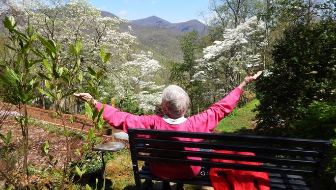 Two years ago, Gay Fox celebrates the coming of spring in the North Fork Valley by embracing the view of Craggy Dome.