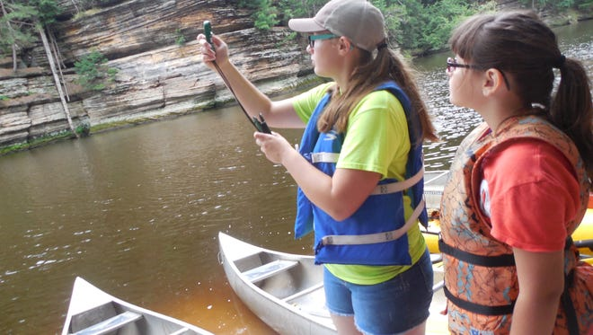 Students partake in citizen science through Upham Woods Outdoor Learning Center.