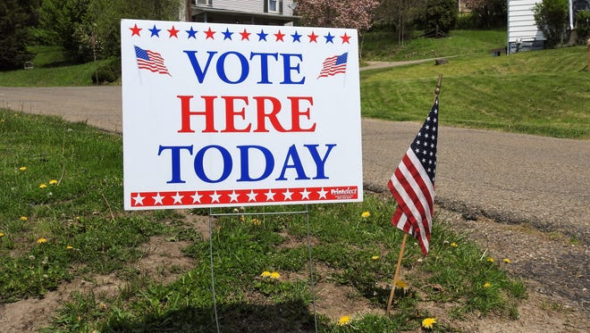 Roscoe United Methodist Church, where this sign and flag was posted, was one of the polling locations for Coshocton County voters on Tuesday for the primary election.