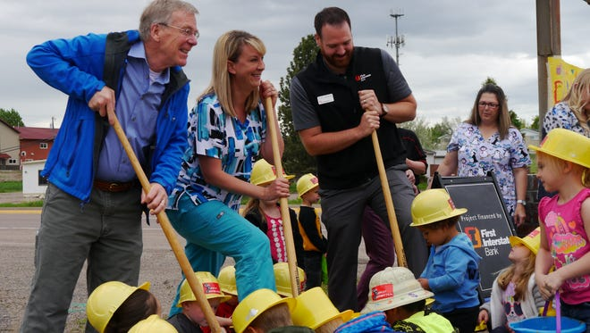 From left, Great Falls Mayor Bob Kelly, Play 'n' Learn Preschool and Daycare owner Raegen Breeden and Scott Anderson of First Interstate Bank break ground on the Play 'n' Learn Academy, a new childcare facility on the east side of Great Falls.