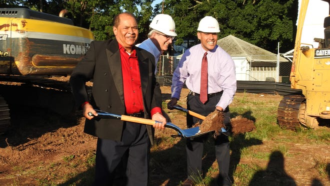 Church leaders, congregants, and construction project managers from Fenton Construction gather for the official groundbreaking ceremony of the new Pentecostal Council Church of God facility. Pictured from left to right (with shovels): Rev. Bernardo Mendez (co-pastor), Michael J. Mulcahy (president & CEO of Fenton Construction), and Rev. Luis A. Gonzalez (lead pastor).