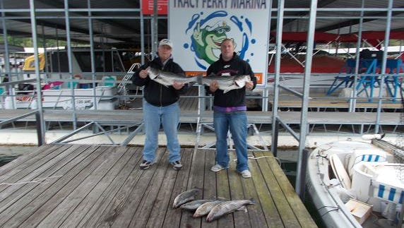 Striper fishing is improving on Norfork Lake, as shown by Eric and his dad, Don.