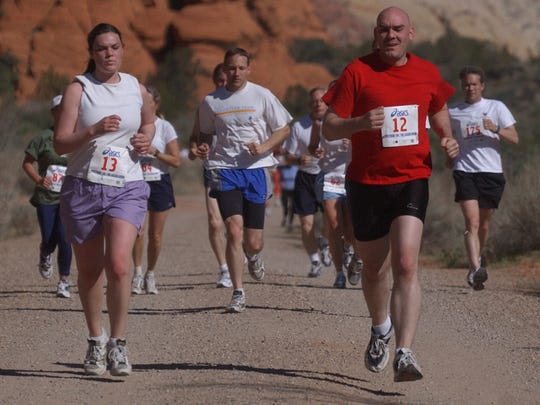 Runners in the Spectrum 10K make their way through Snow Canyon State Park, one of several major events that encouraged park managers to consider changes to roadways.