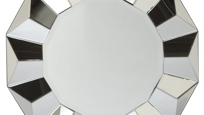 A faceted Portico mirror from Z Gallerie makes a dramatic statement over a mantel or in an entryway.