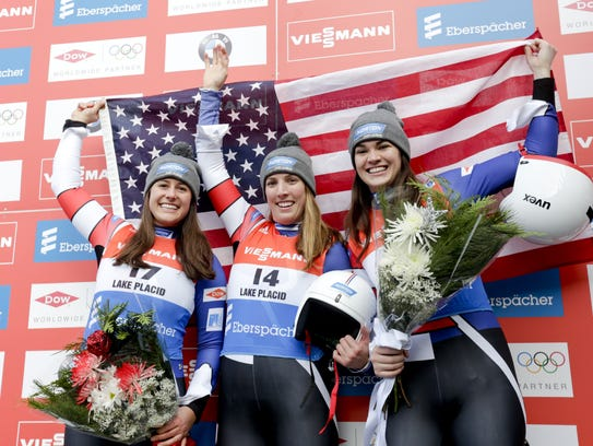 Erin Hamlin, center, celebrates after leading a U.S. sweep of the women's luge World Cup at Lake Placid in December 2016. Emily Sweeney, left, was second and Summer Britcher third. Britcher, of Glen Rock, and Hamlin head into the World Cup in Latvia atop the overall world standings.
