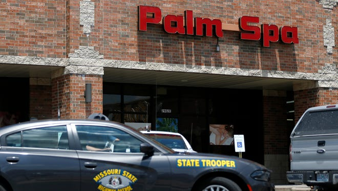 Missouri State Highway Patrol cars sit outside Palm Spa at 2902 S. Campbell Ave. on Thursday, July 20, 2017. The massage parlor is one of more than a dozen Asian massage parlors in Greene County raided as part of a sex trafficking probe on Thursday.