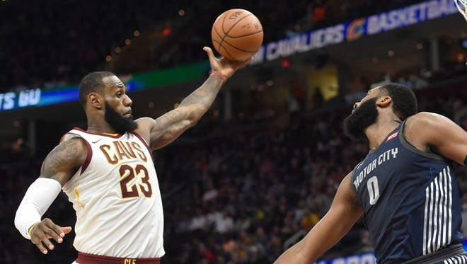 Cleveland Cavaliers forward LeBron James (23) rebounds beside Detroit Pistons center Andre Drummond (0) in the second quarter at Quicken Loans Arena.