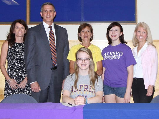 Elisabeth Estep during her signing ceremony to attend Alfred University while a senior at Horseheads in 2015. Also pictured, from left, are her stepmom Jeanne Estep, dad Matt Estep, Horseheads coach Patti Perone, sister Katherine Estep and mom Christine Estep.