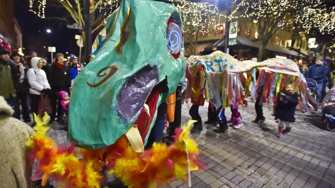 A dragon from the Integrated Arts Academy snakes down Church Street during the dancing dragons parade during First Night in Burlington on Wednesday.