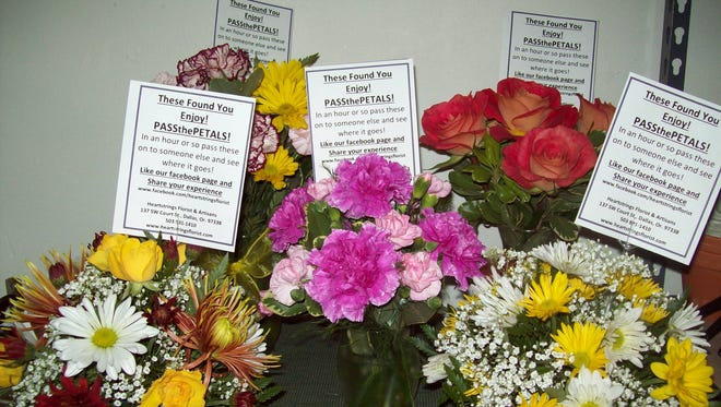"""Linda Taylor, owner of Heartstrings Florist & Artisans in Dallas, delivered this five """"Pass the Petals"""" bouquets to local businesses on Oct. 7, 2015."""